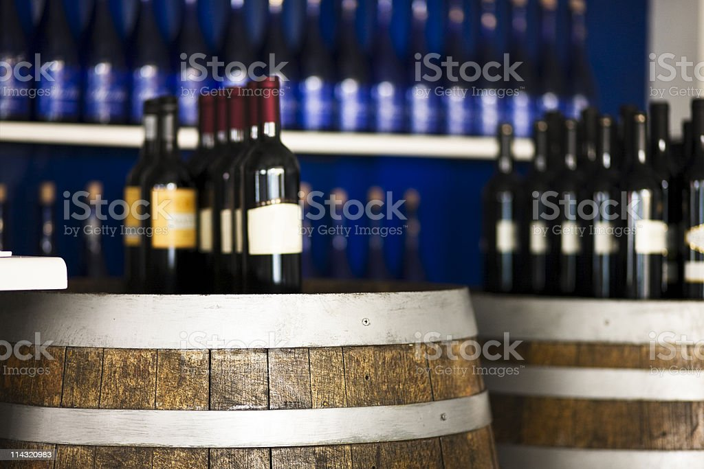 Wine bottles and barrels royalty-free stock photo