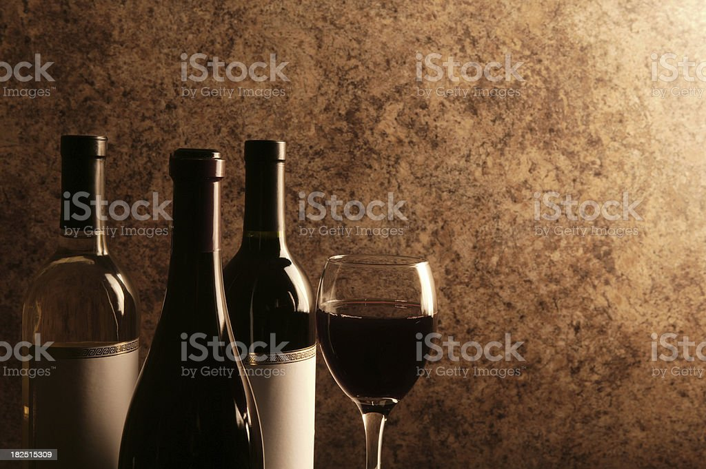 wine bottles and wineglass stock photo