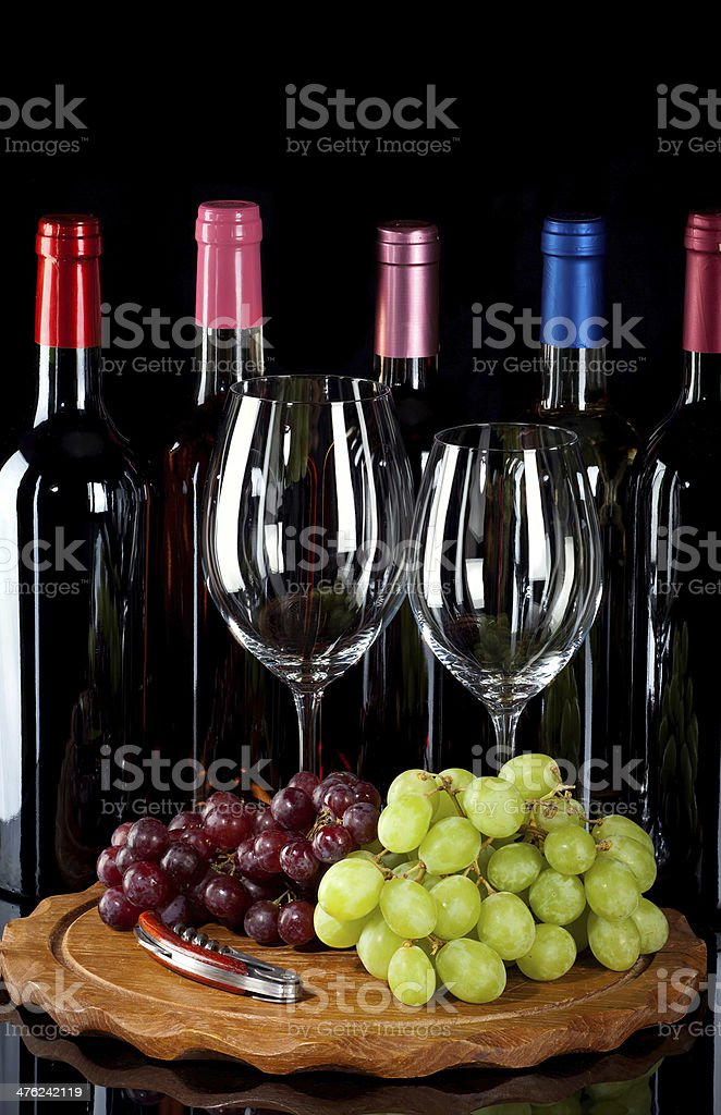 Wine bottles, glasses and grapes royalty-free stock photo