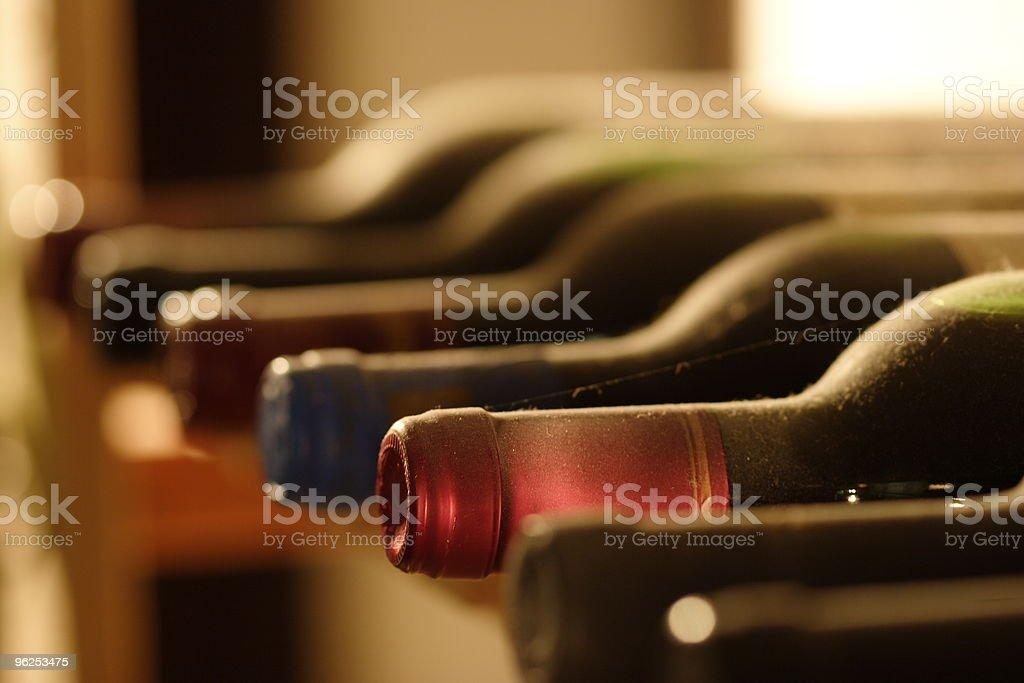 wine bottles in a shelf stock photo