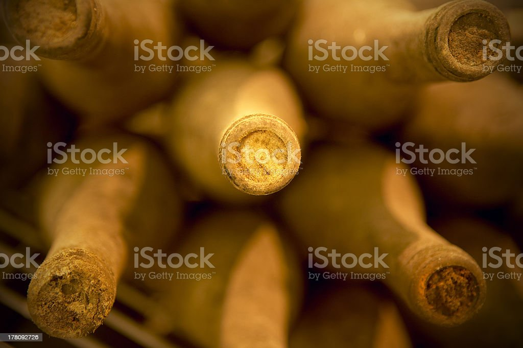 Wine bottles in an aging cellar royalty-free stock photo