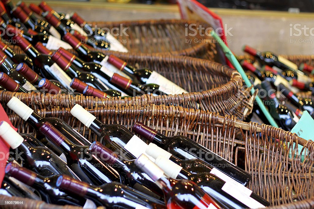 Wine bottles in baskets stock photo