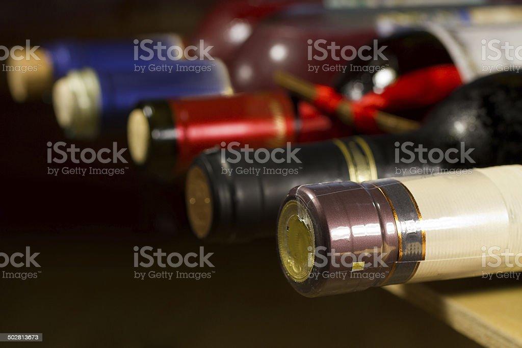Wine bottles in cellar. royalty-free stock photo