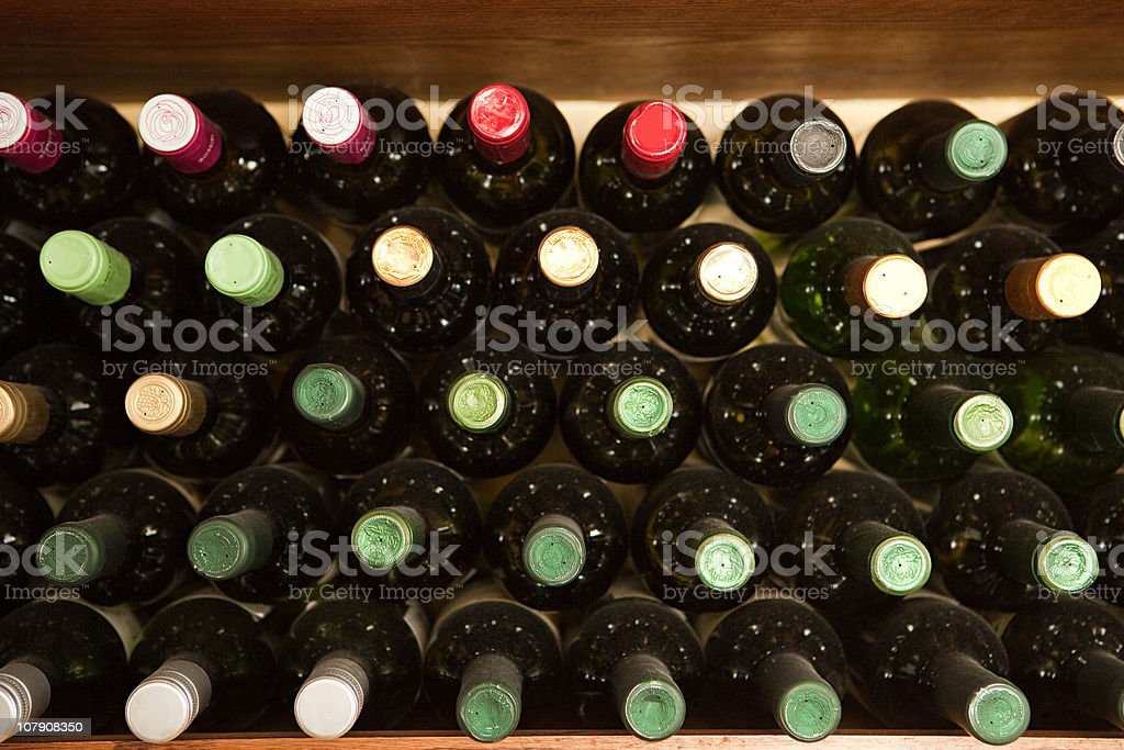 Wine bottles in restaurant wine rack stock photo