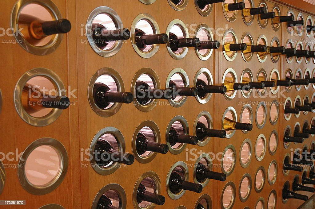 Wine Bottles in Wall Rack royalty-free stock photo