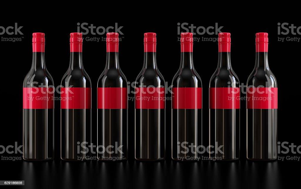 Wine bottles isolated on black stock photo