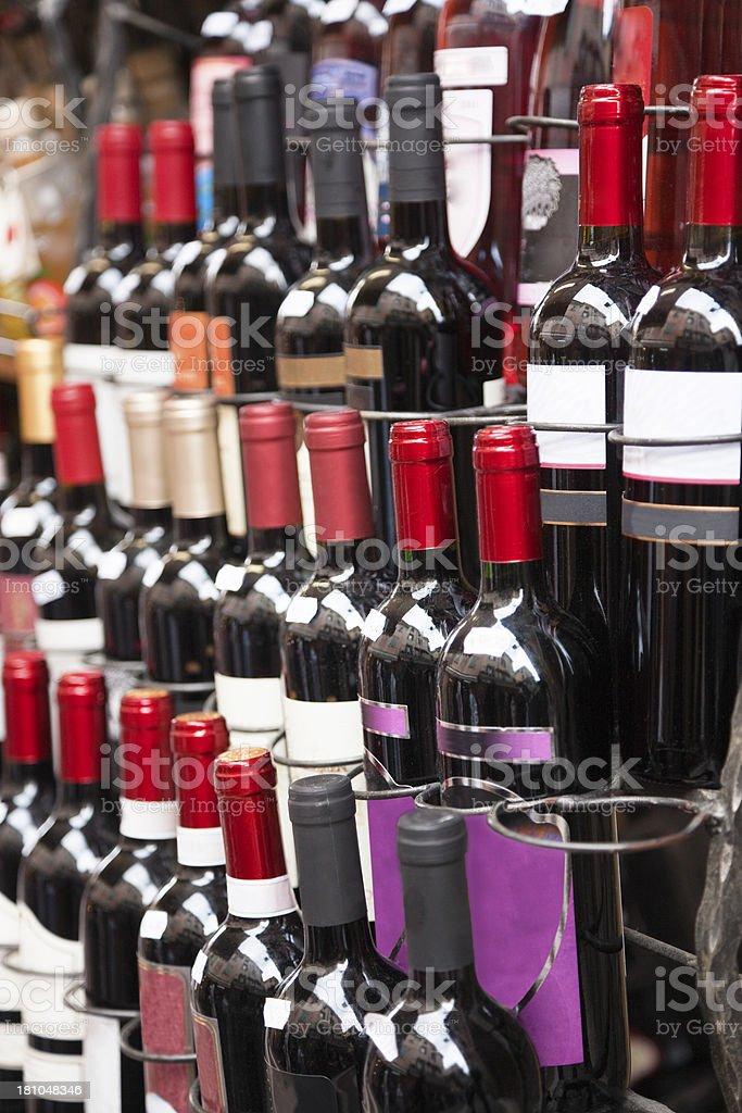 Wine bottles on a market royalty-free stock photo