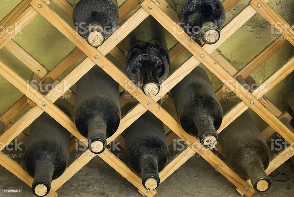 Wine bottles on a rack royalty-free stock photo
