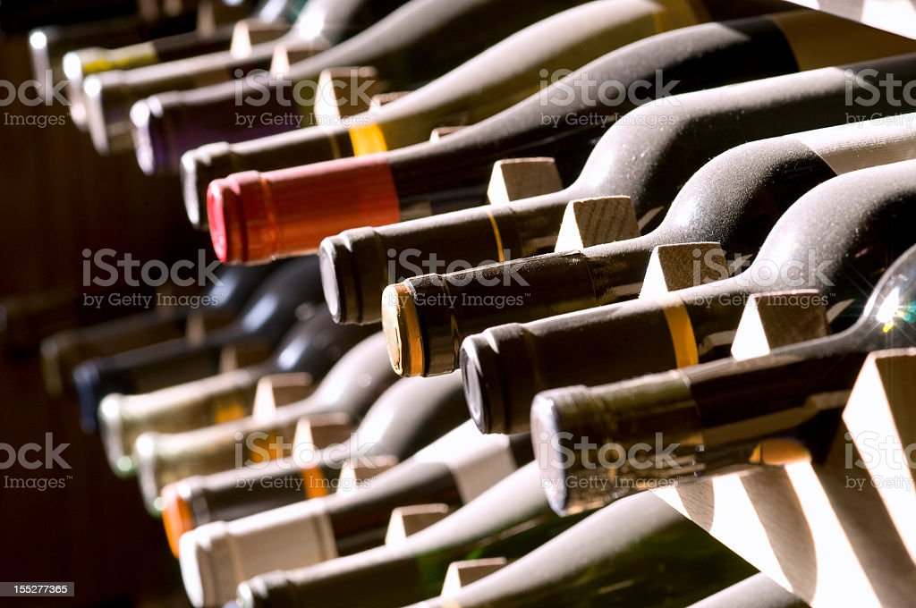 Wine Bottles on Rack stock photo