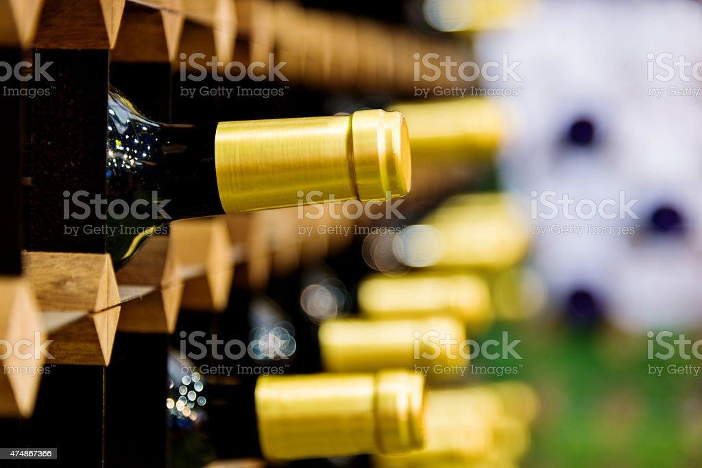 Wine bottles on rack stock photo