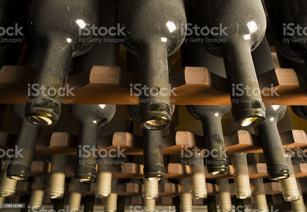 Wine bottles on shelf royalty-free stock photo