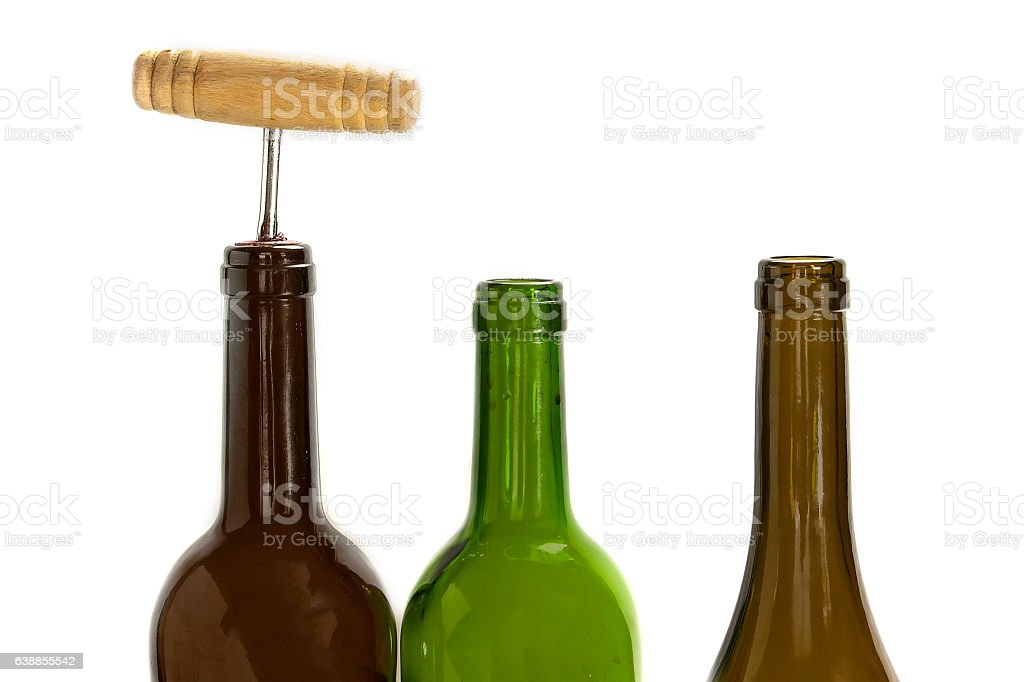 Wine bottles, one of them corked, on white stock photo