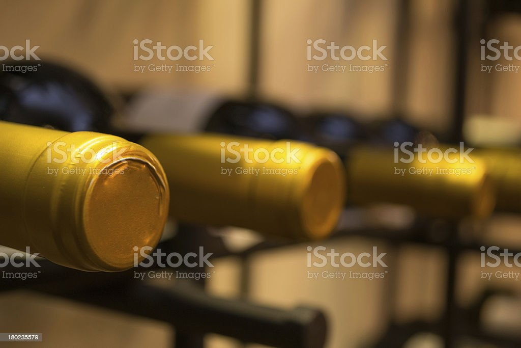 Wine bottles stacked on racks royalty-free stock photo