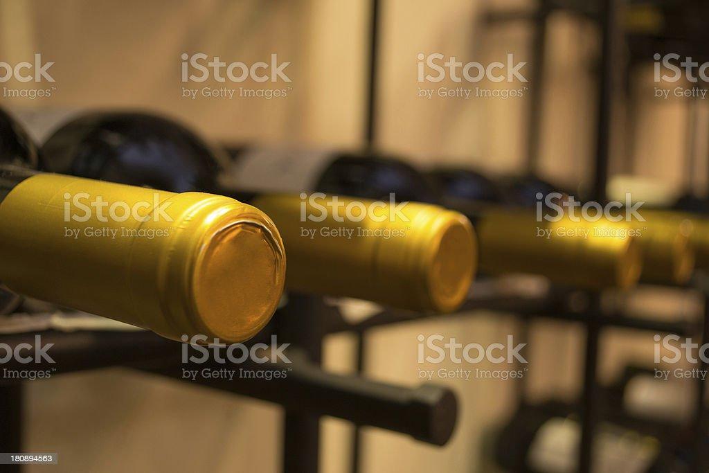 Wine bottles stacked on racks royalty-free stock photo