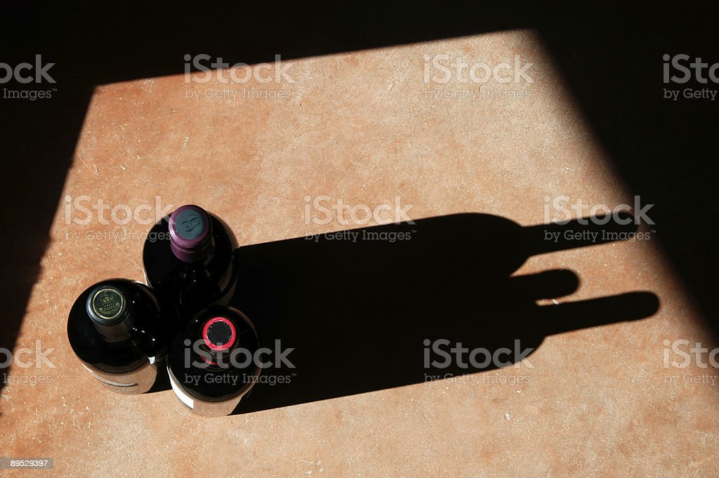 Wine Bottles with Dramatic Shadow royalty-free stock photo