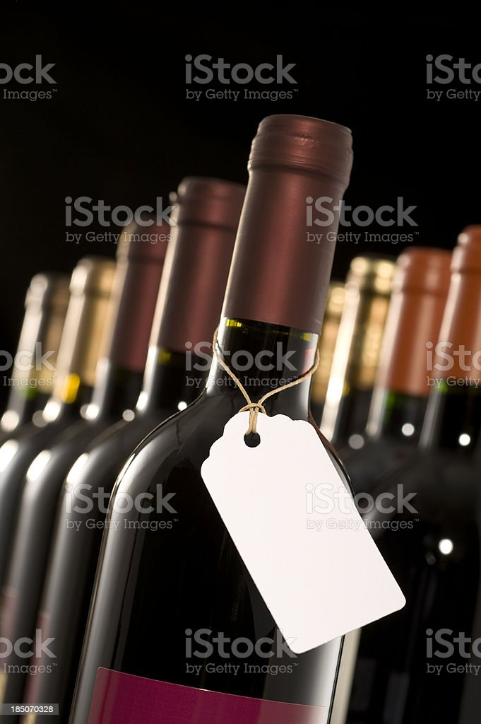 Group of wine bottles with a blank label.