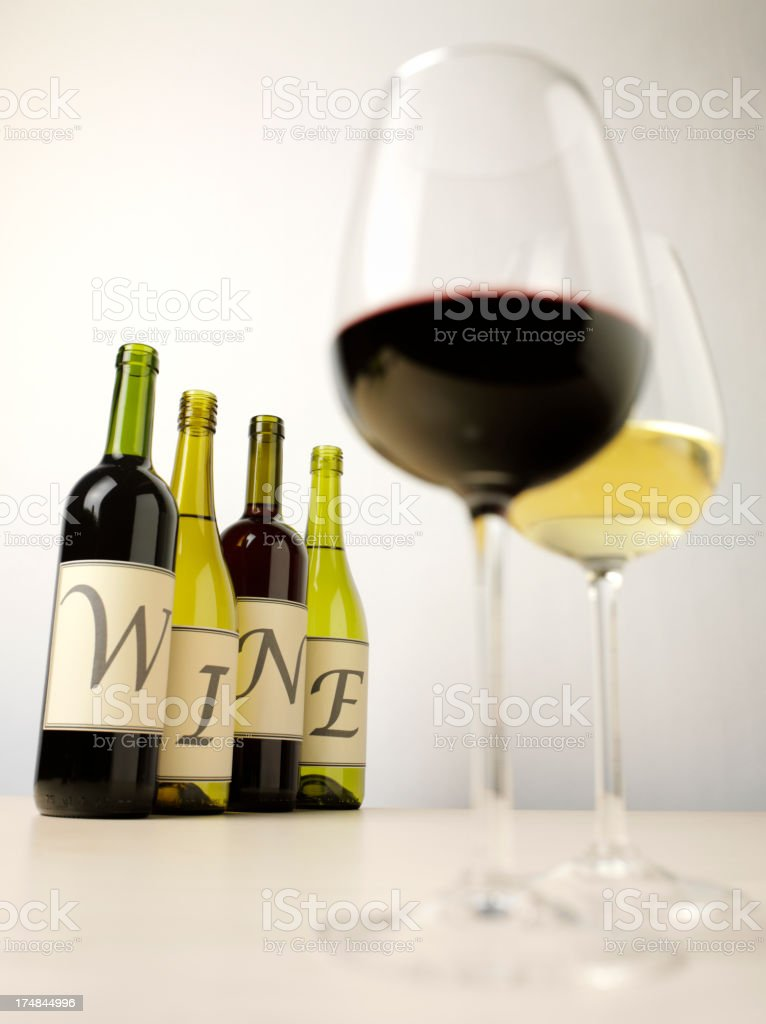 Wine Bottles with Red and White in Glasses royalty-free stock photo