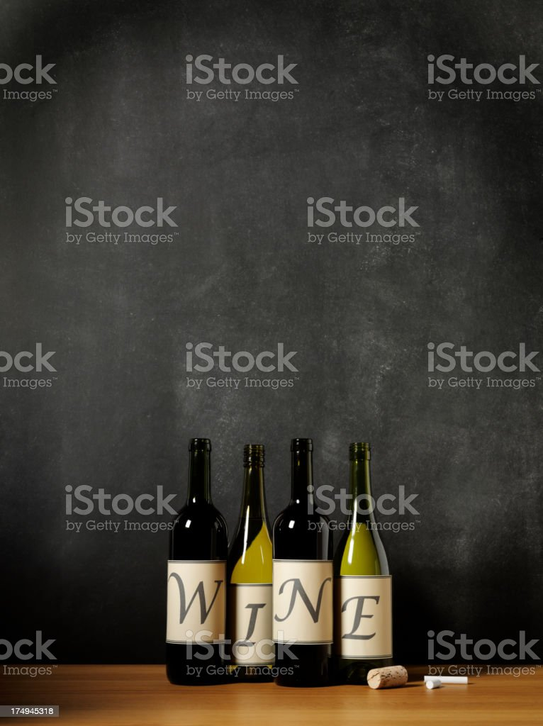 Wine Bottles with W I N E and a Blackboard stock photo