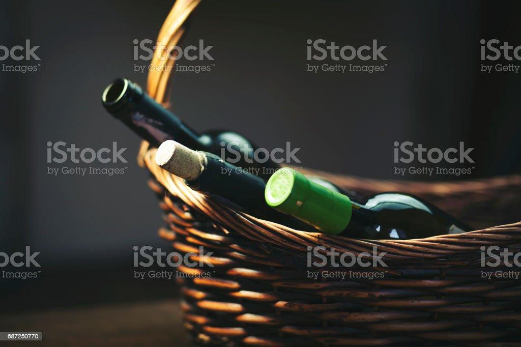 wine  bottols on basket stock photo