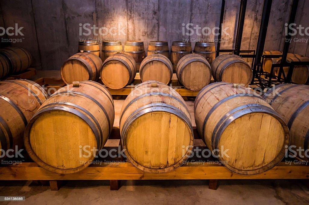 wine brandy whisky cellar multiple barrels barrel light horizontal wood stock photo
