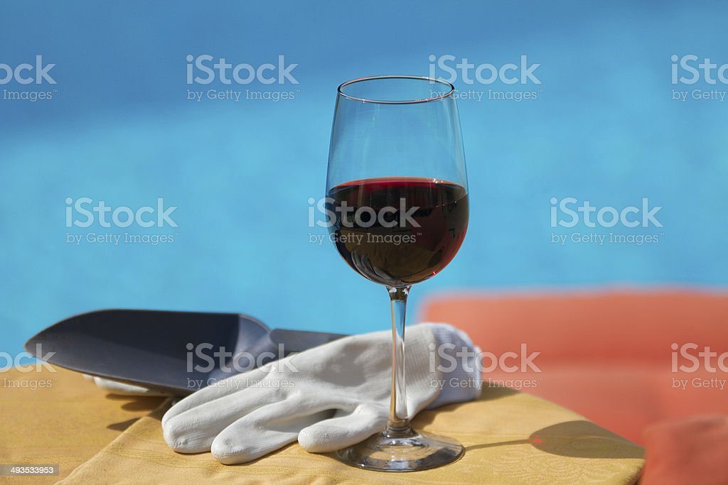 Wine by the pool stock photo