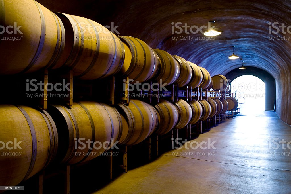 Wine cave with oak barrels in Napa Sonoma California winery stock photo