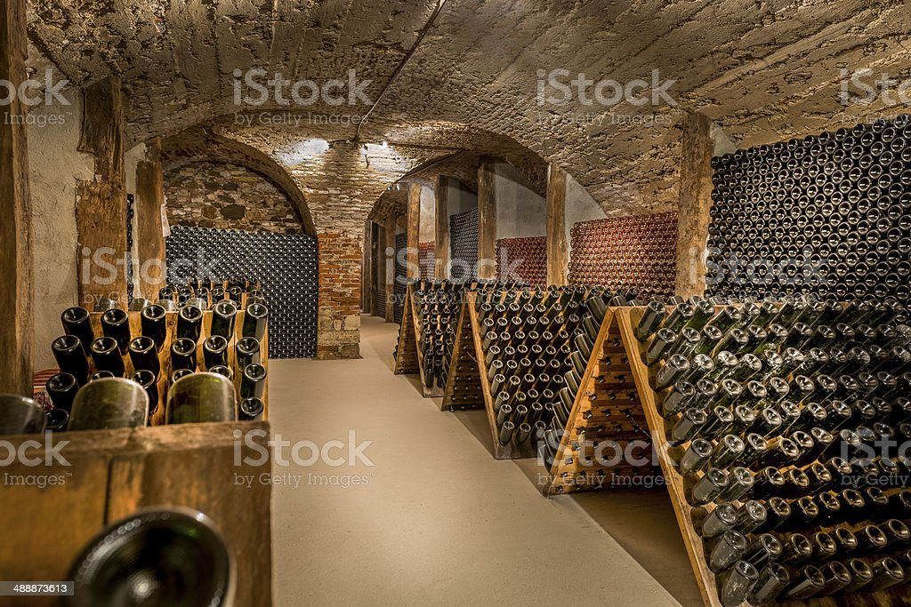 Wine cellar, a row of champagne bottles stock photo