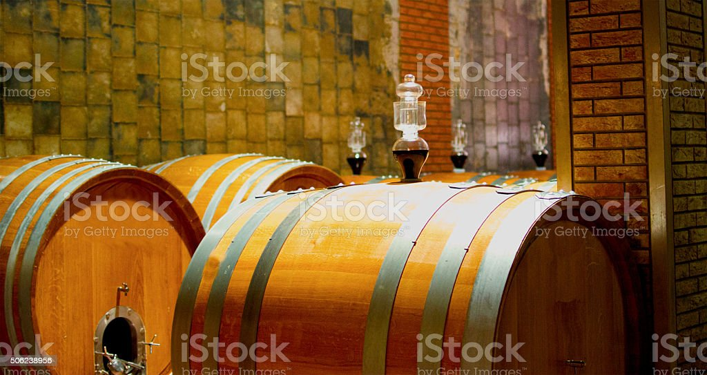 Wine cellar with barrels stock photo