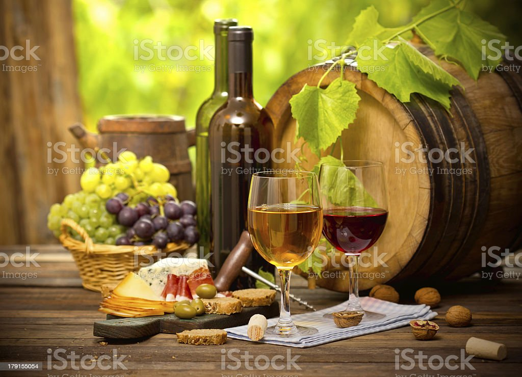 Wine, cheese, and grapes spread on a table royalty-free stock photo