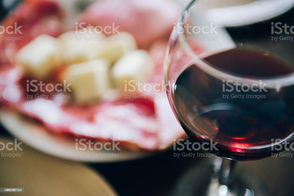 Wine, cheese and prosciutto stock photo