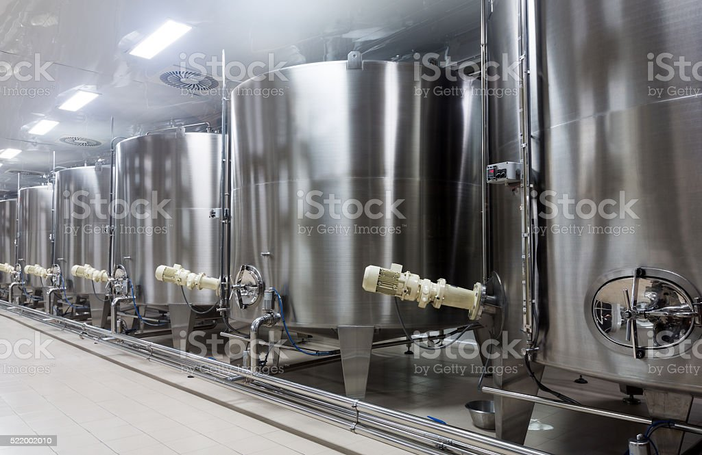 Wine cisterns under temperature control in winery stock photo