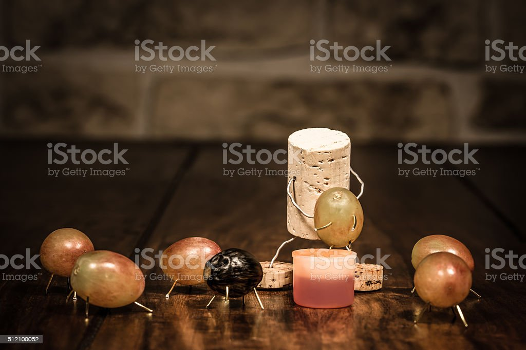 Wine cork figure, Concept Man squeezing out grapes stock photo