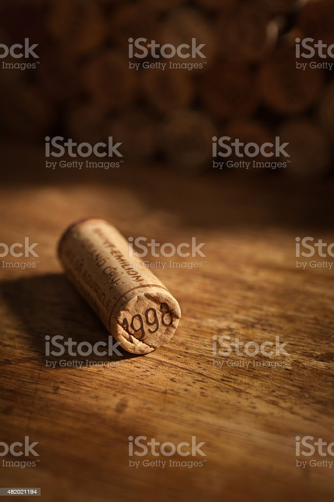 Wine Cork Stoppers with Vintage Year on Rustic Wood Background stock photo