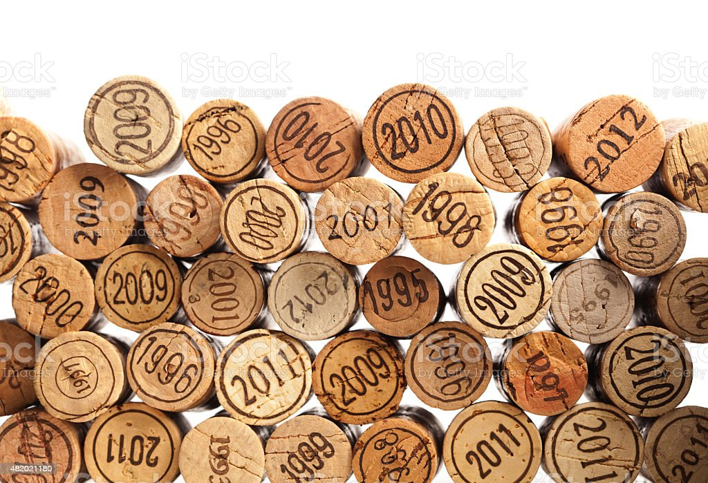 Wine Cork Stoppers with Vintage Year on White Background stock photo