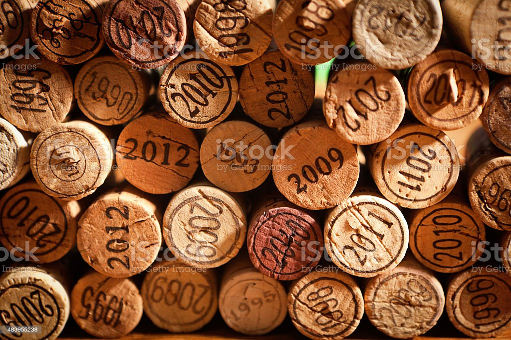 Wine Cork Stoppers with Vintage Years Background stock photo