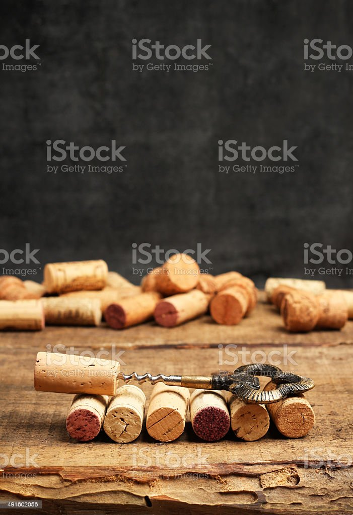 Wine corks and corkscrew on a wooden table stock photo