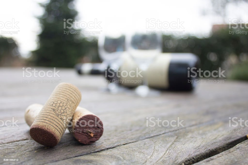 Wine Corks and Wineglasses on the Wooden Table stock photo