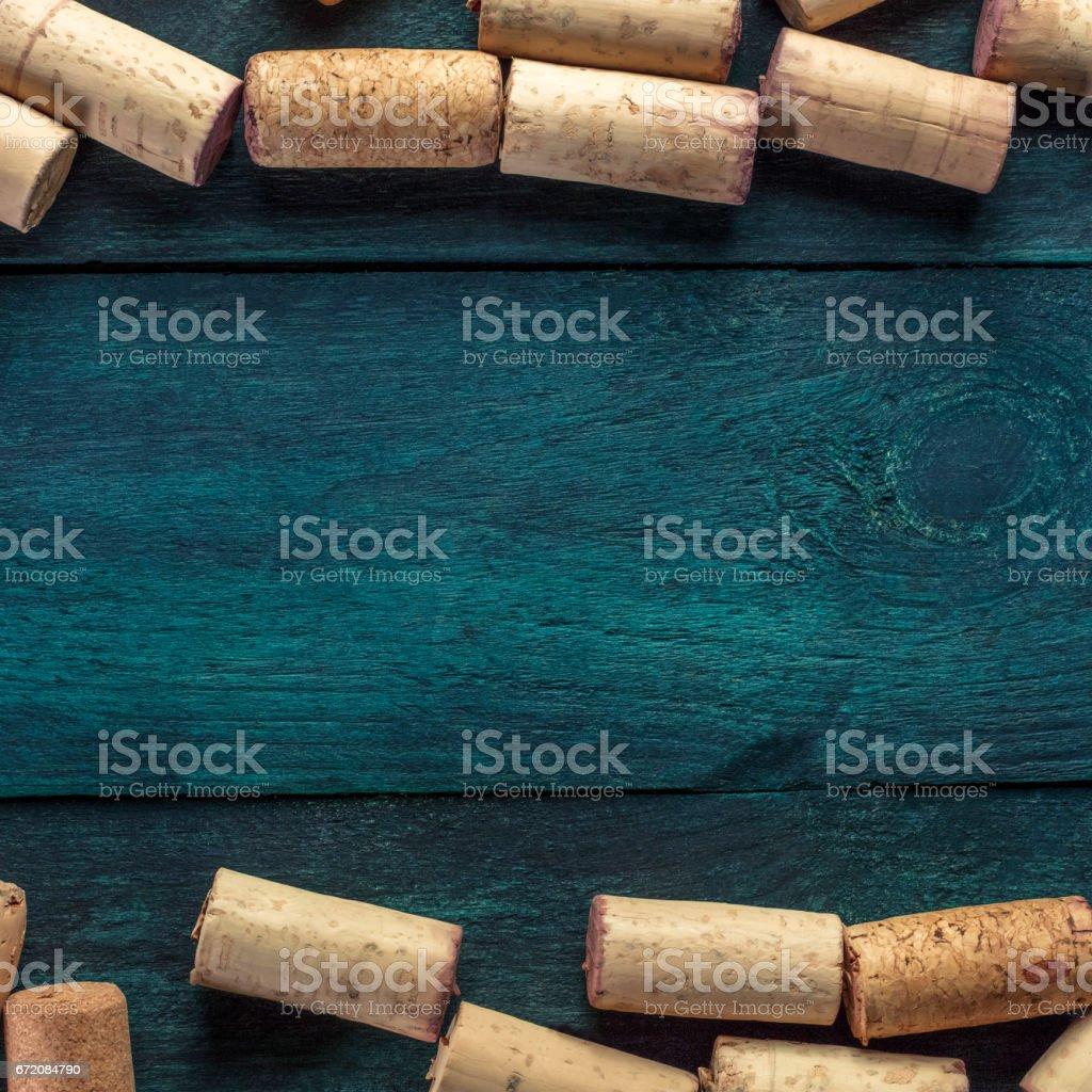 Wine corks on dark wooden texture with copyspace stock photo