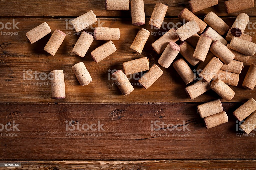 Wine corks over an old wood table stock photo