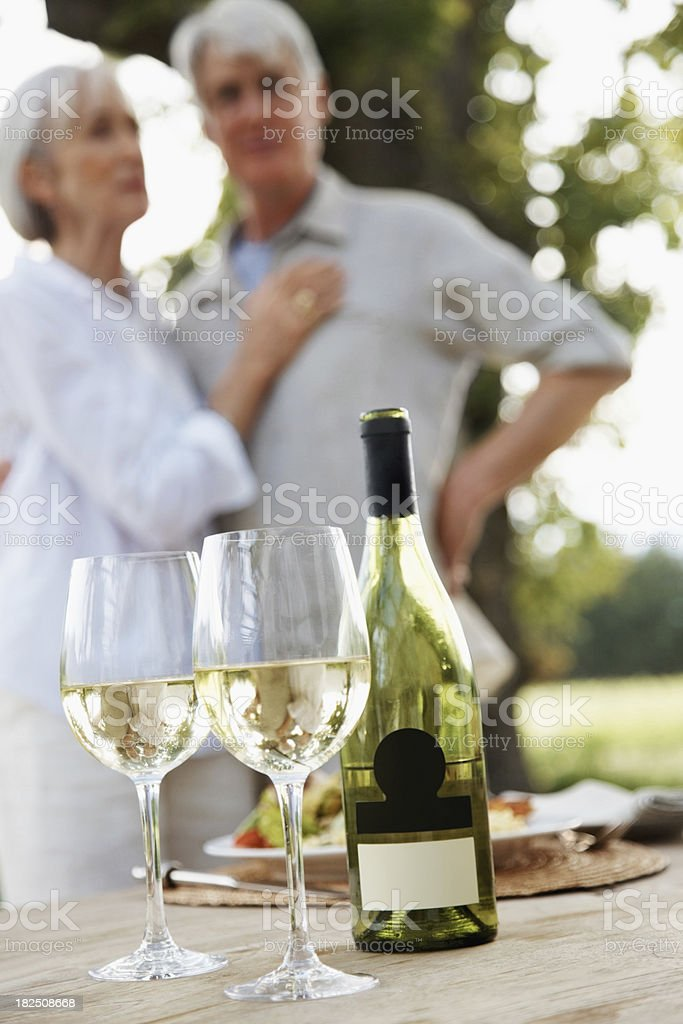 Wine displayed on a table with couple at the background royalty-free stock photo