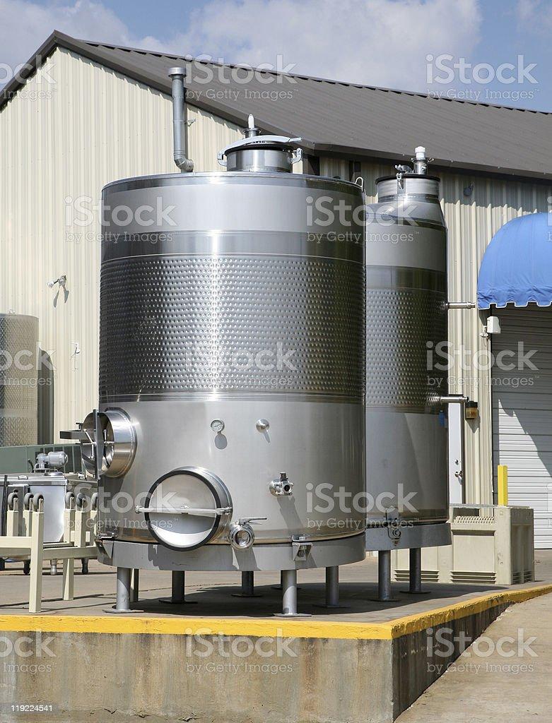 Wine fermenting or storage tanks stock photo