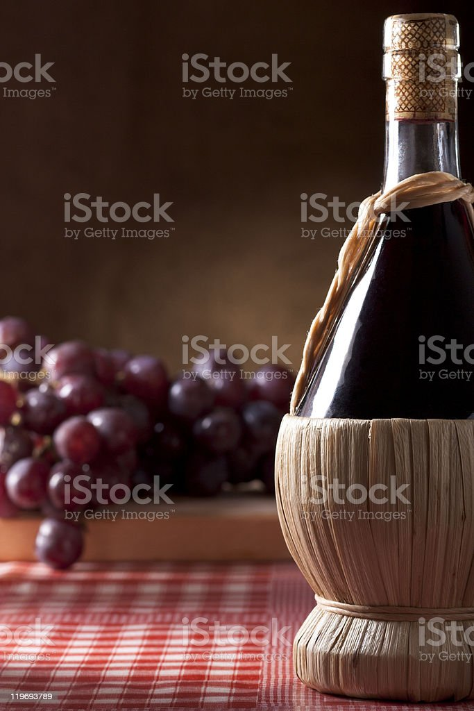 Wine Flask with Grapes royalty-free stock photo