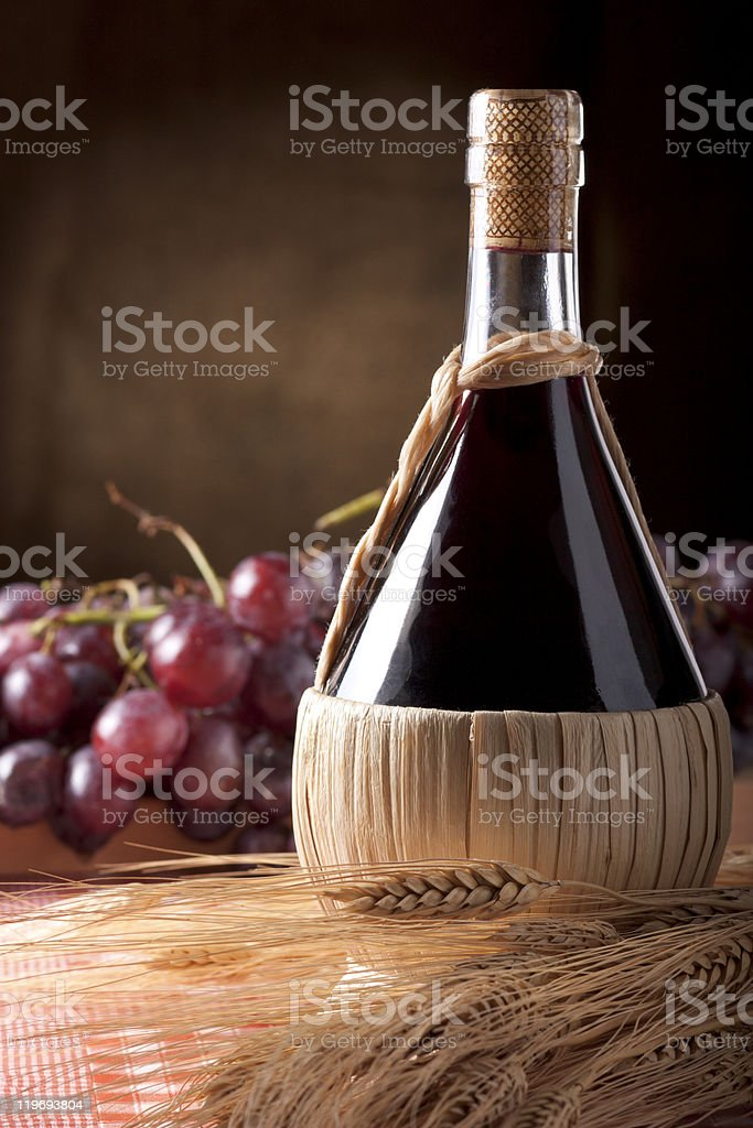 Wine Flask with Wheat and Grapes royalty-free stock photo