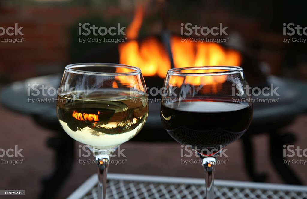 Wine For Two By The Outdoor Firepit royalty-free stock photo