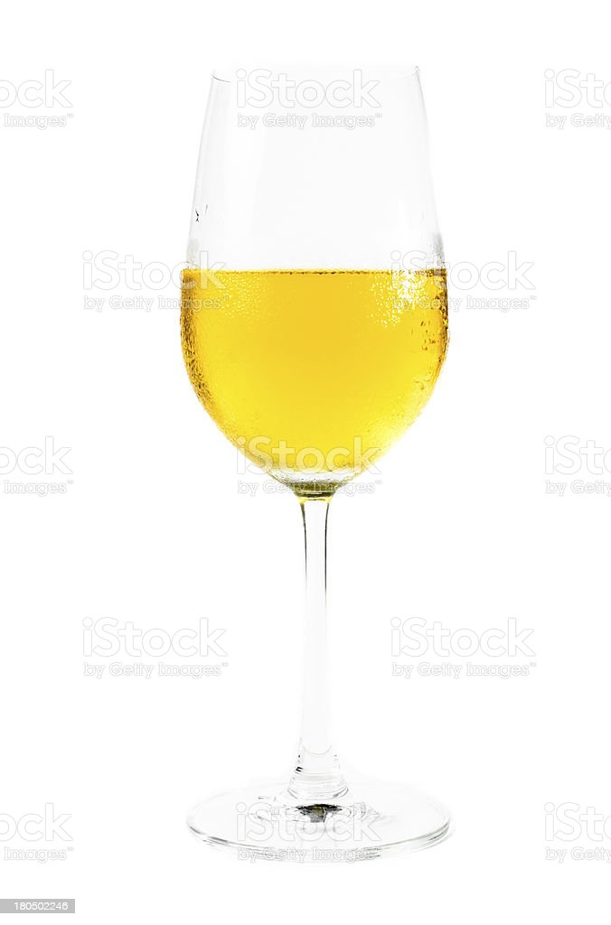wine glass and yellow water royalty-free stock photo