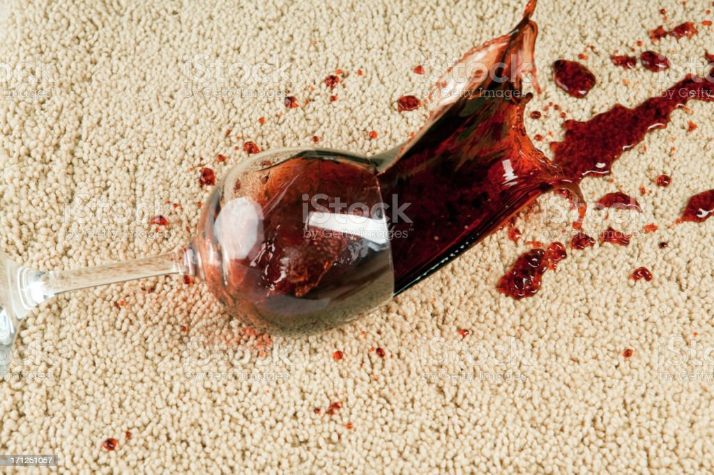 Wine Glass Falls onto Carpet stock photo