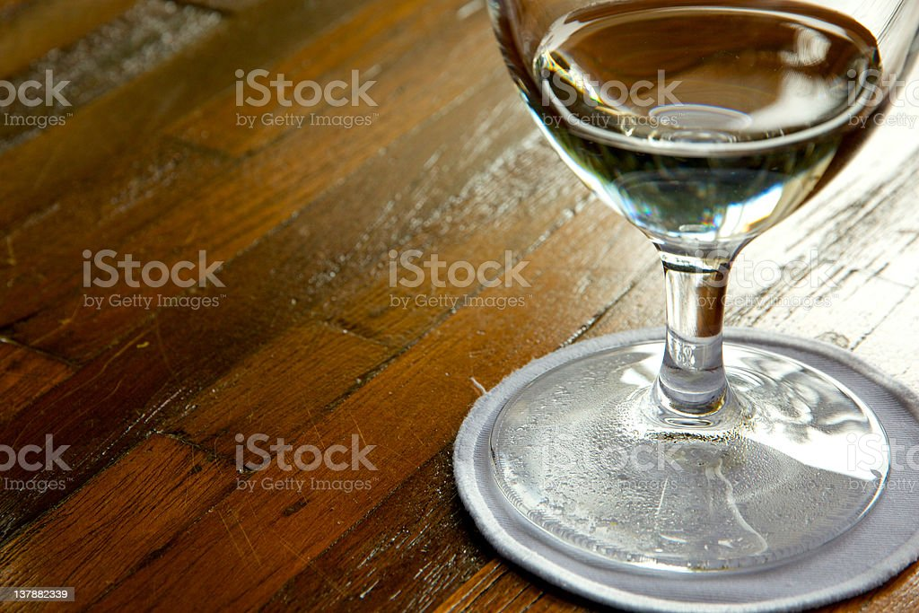Wine glass filled with water stock photo