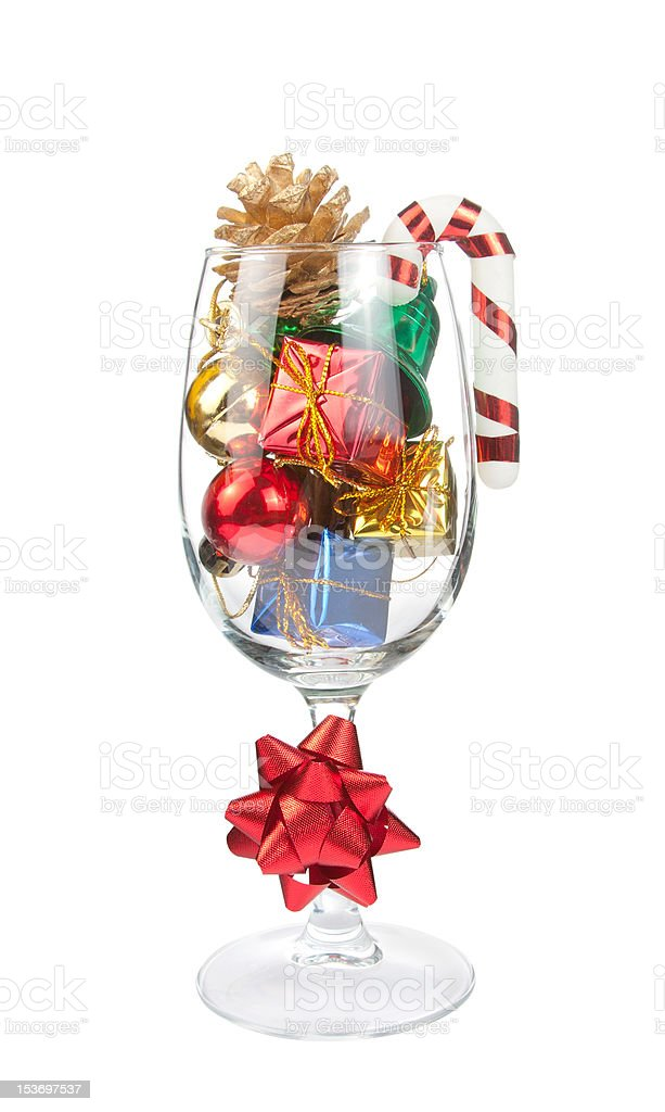 Wine glass full of Christmas decorations royalty-free stock photo