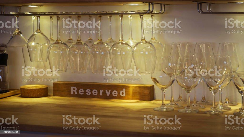 Wine glass hangs on a glass rack. stock photo