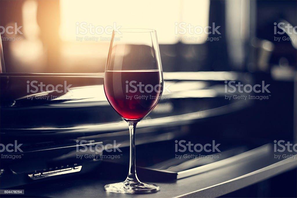 wine glass in entertaining room among sunset window background stock photo